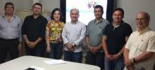 Imagem com os membros do Comitê de Tecnologia da Informação reunidos na Reitoria